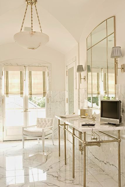 beautiful traditional style decor in a neutral white color palette master bathroom