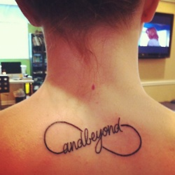 Candle Ink tattoo on back neck