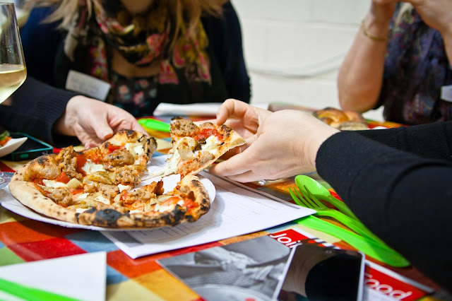 Bloggers sharing delicious pizza
