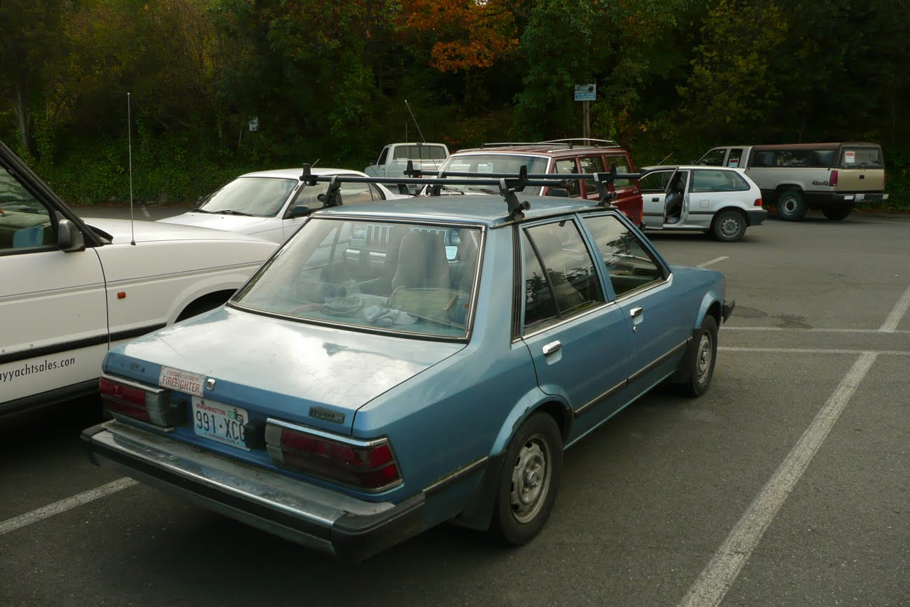Old Parked Cars Mazda Glc Sedan