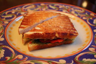 Chicken panini with pesto, roasted bell peppers and mozzarella