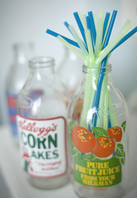 vintage milk bottles with coloured straws