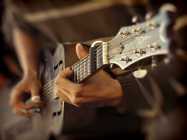 vintage colors soft focus hands playing old guitar