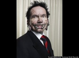 Rolf Buchholz - Most Pierced Man
