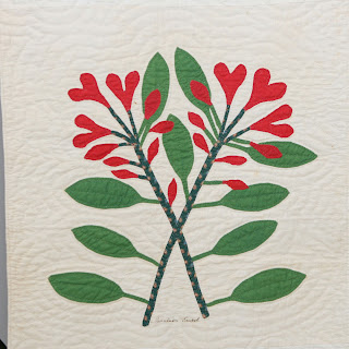 "History and Details of the Original Block Row Four, Column  One, Sew Along Block 3 ""This plant, a harbinger of Spring, grows wild in the Appalachian Mountains. The design ""Laurel Leaves,"" especially with crossed stems, was a favorite of quilters in this part of the Valley during the mid-1800s."" ...Neva Hart"
