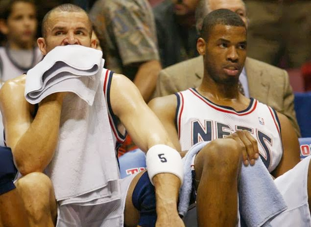 Former Nets center Jason Collins on the bench next to Jason Kidd