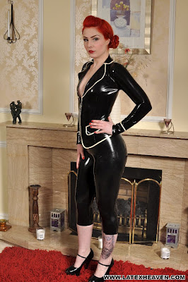 Sexy Redhead Leanne James in Black Latex Suit and heels