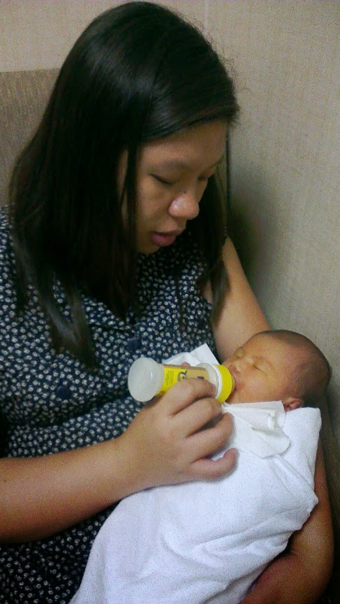 Picture of Kei bottlefeeding Elise on July 12, 2013, 9:00pm
