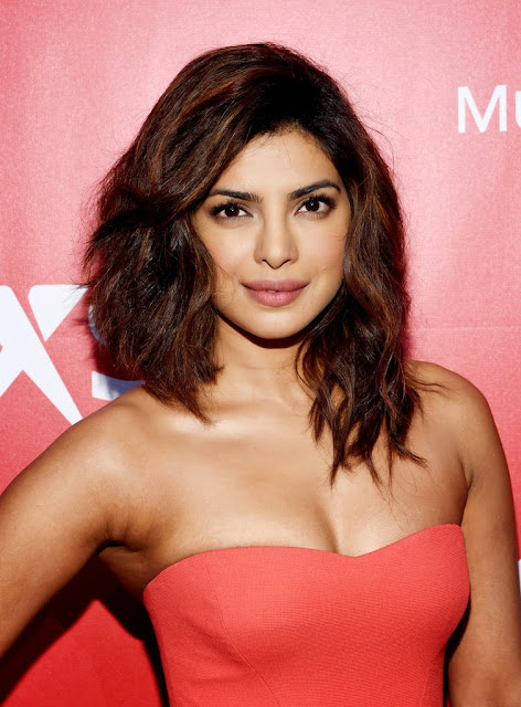 Priyanka Chopra in Orange Gown 2015 MusiCares Person Of The Year Gala Honoring Bob Dylan Los Angeles+1.jpg