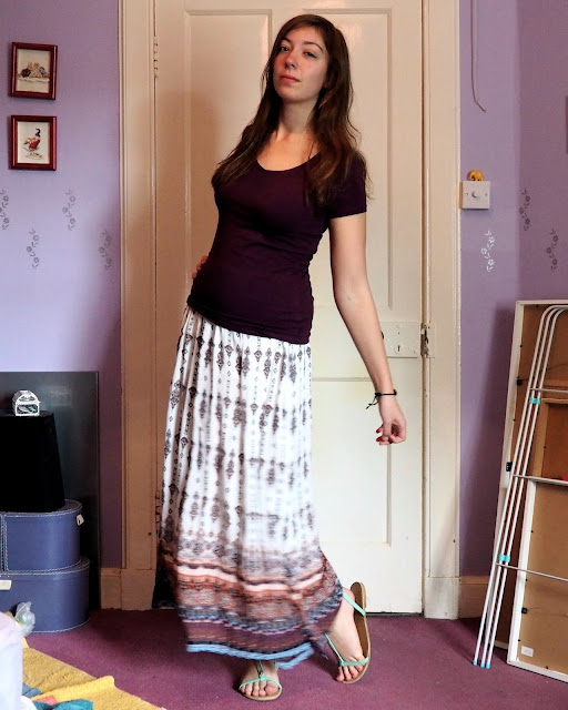 Ethereal | outfit of plain purple top, patterned maxi skirt and green strappy sandals