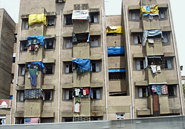 clothes hanging out to dry on tiny balconies