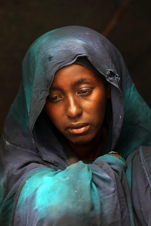 Safia Adem mourning Hamza Ali Faysal in cathedral of Mogadishu, Somalia.