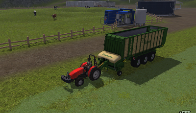 Loading grass to wagon