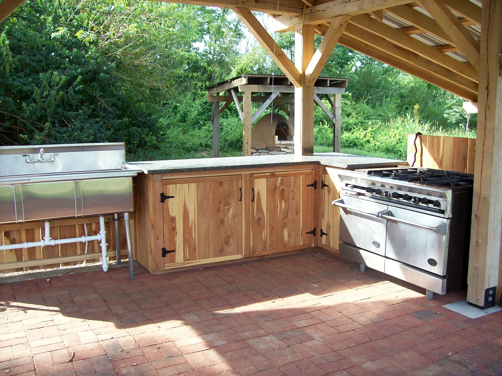 Rising earth the oxmoor farm outdoor kitchen for Outdoor kitchen cabinets