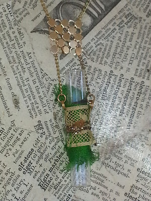 decorated recycled glass vial necklace with green sari silk