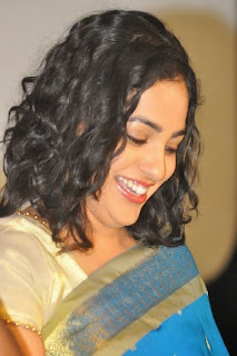 Actress Nitya Menon Pictures in Saree at Malini 22 Audio Launch  0033