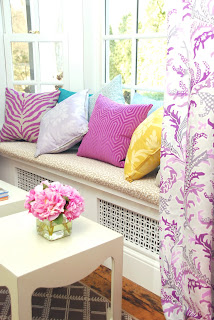 colored pillows on window bench