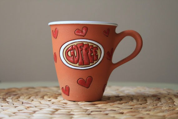 https://www.etsy.com/listing/98743222/tall-coffee-mug-with-hearts-clay-pottery?ref=favs_view_2