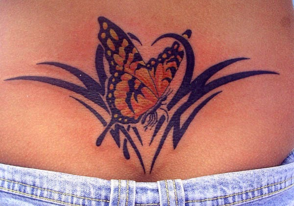 Female Lower Back Tribal With Butterfly Tattoo Design Idea
