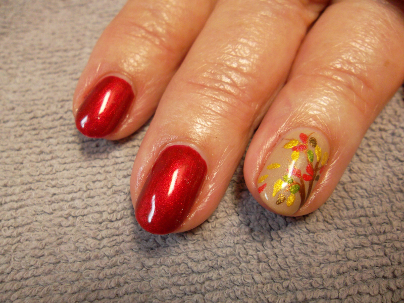Closeup of hard gel fill with gel polish and fall foliage nail art