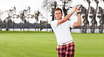 Ian Poulter wearing tartan trousers on the golf course