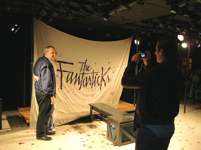 Posing in front of the Fantasticks curtain