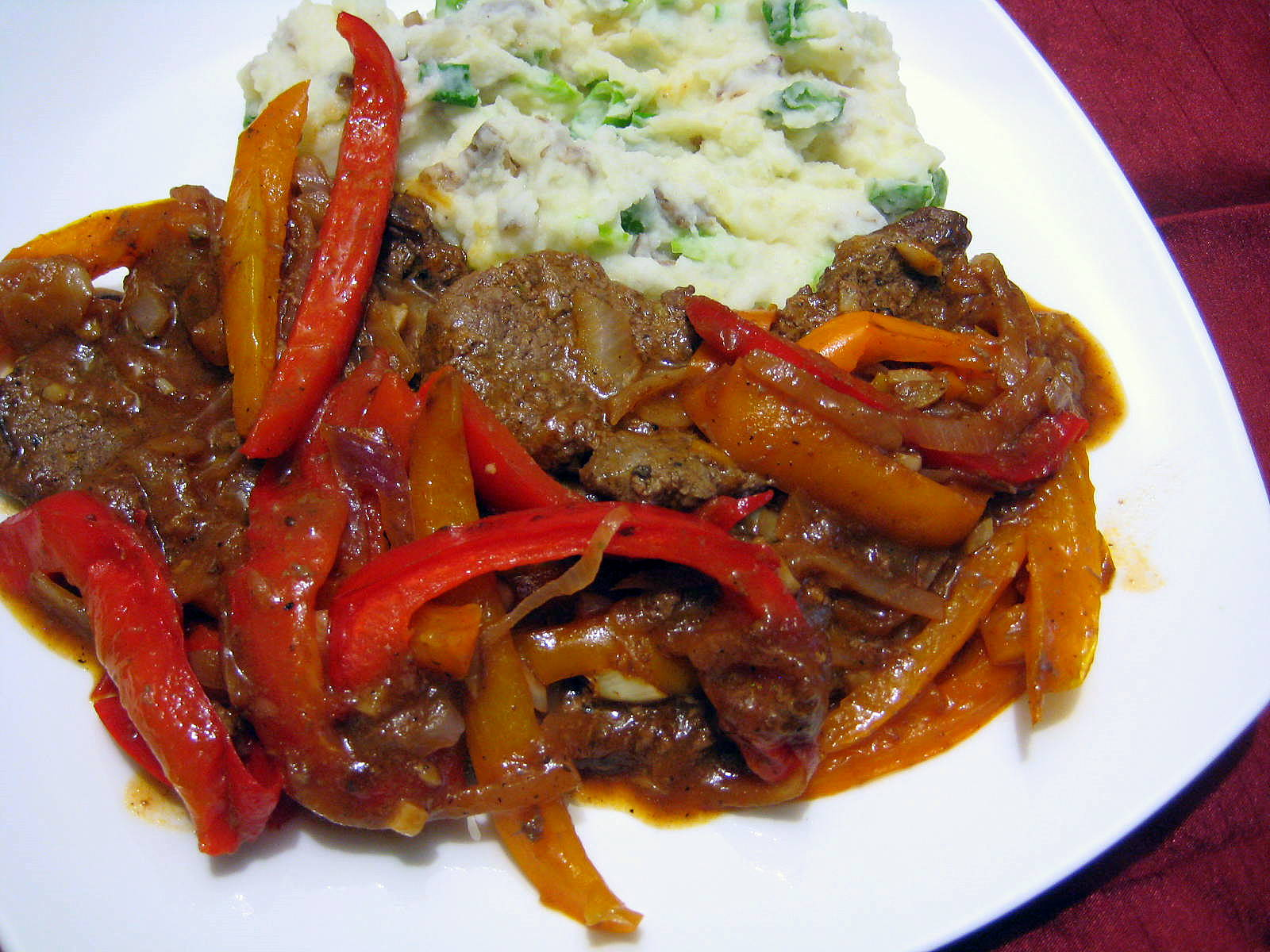STEAK, PEPPERS & ONIONS IN A BROWN SAUCE