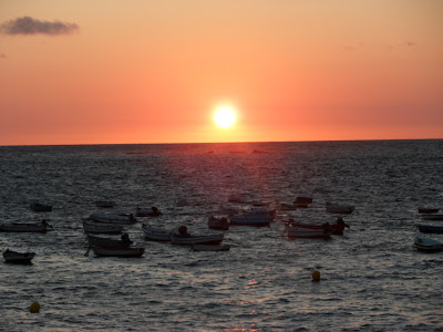 Sunset and fishing boats off the peninsula of Cadiz, Spain