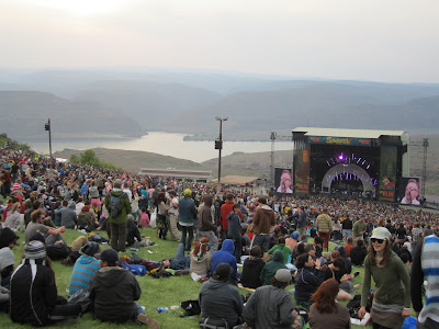 Photo of concert stage in front of mountains