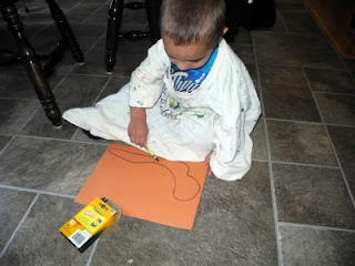 toddler drawing a snail