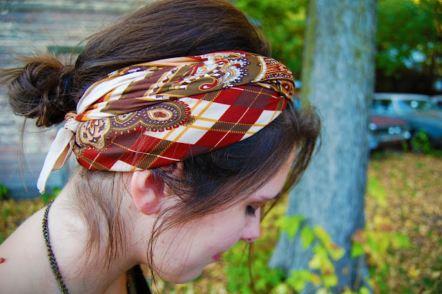 Moroccan headscarf tied as a headband.