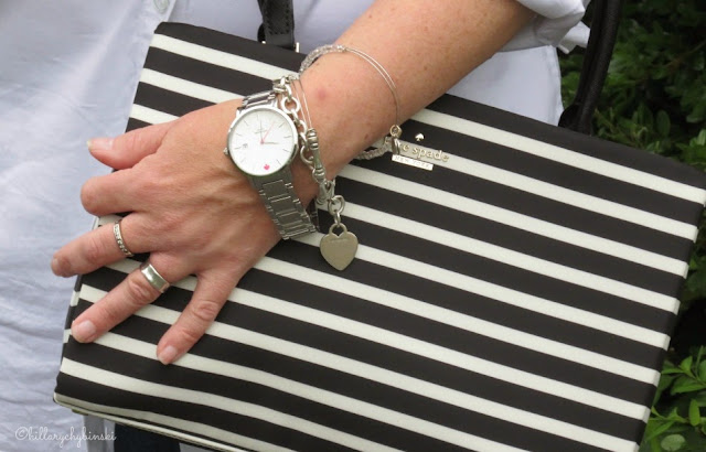 Classic Accessories: Structured Bag, Classic Watch, Silver Jewelry