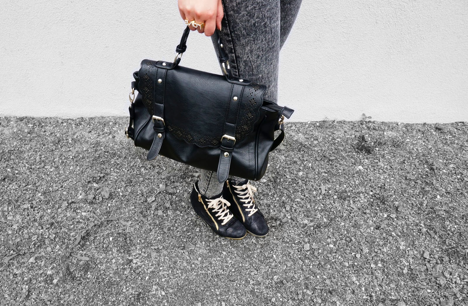 black purse/bag, grey jeans, gold and black shoes wedges