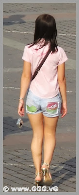 Girl in jean shorts on the street