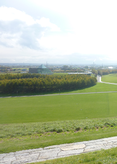 Ring of trees around Sea Fountain and glass pyramid of Hidamari as as seen from play mountain at Moerenuma Park (Moerenuma Koen), Sapporo