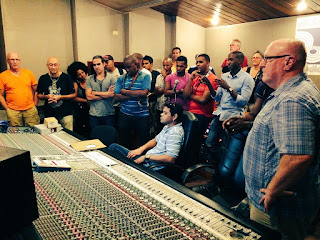 The big band listening to a take