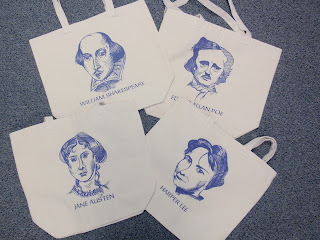 A photo of the front of the totes with each novelist showing.