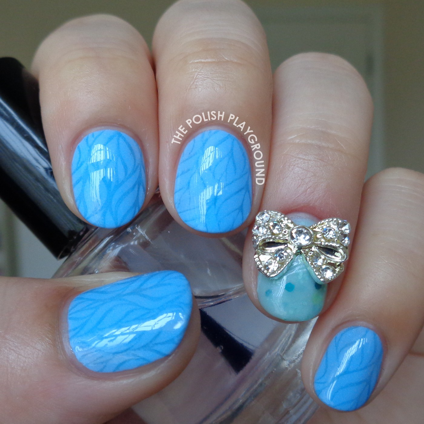 Light Blue Leafy Pattern with Bow Stud Stamping Nail Art