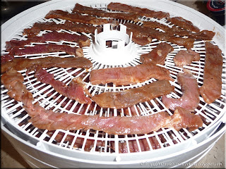 meat slices in the dehydrator