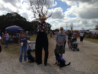 Stiltwalker with Melisa and Bo and Fred and Coach.