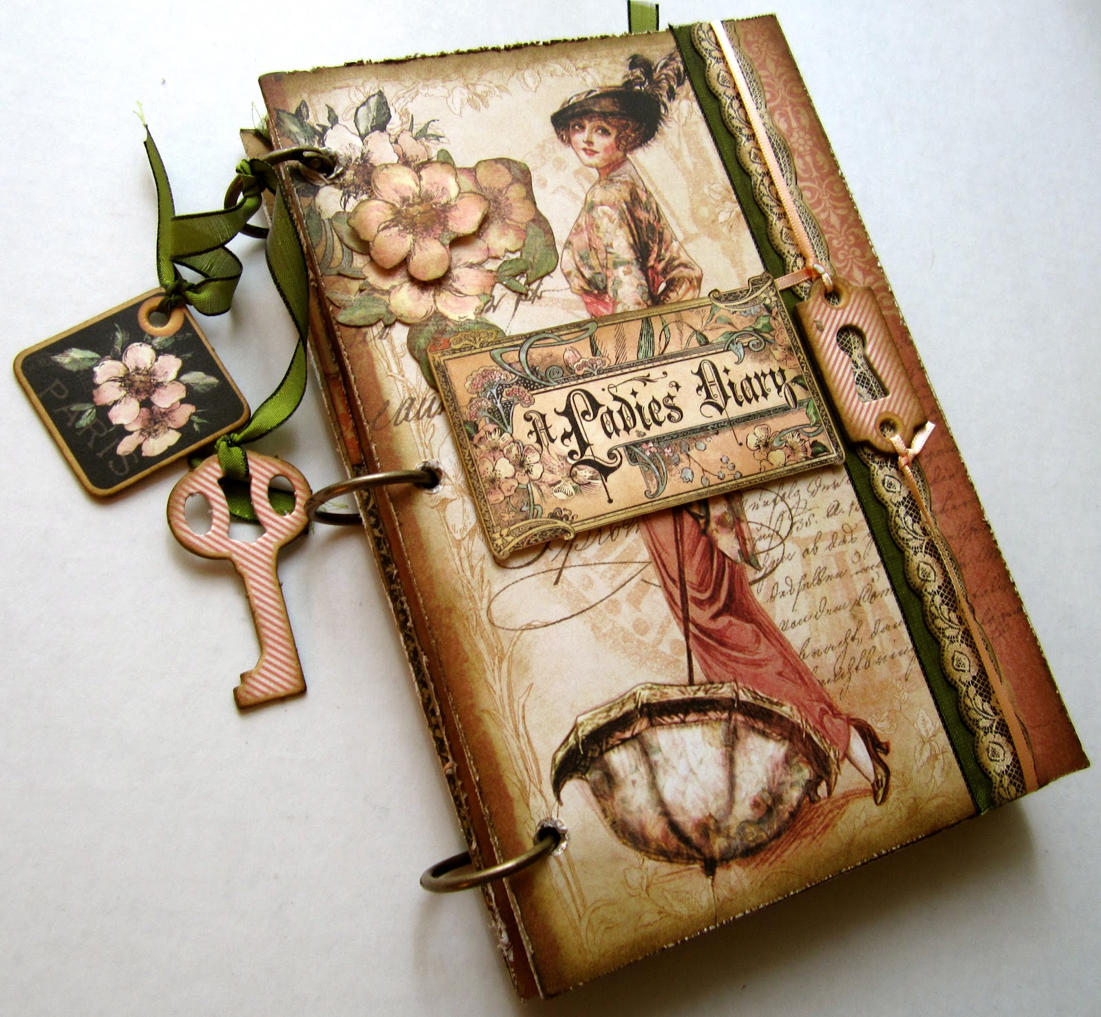 mini album that i made for the mad scrapper i used graphic 45s lovely a ladies diary paper chipboard die cuts and real coffee to make this book