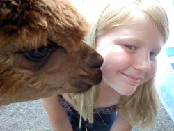 Gwenn and an alpaca, one of the many animals she loves