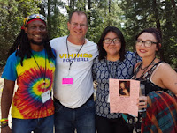 Photo of John with Rio students at a widerness retreat