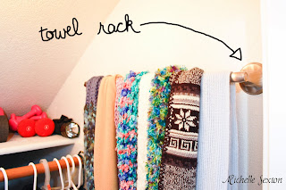 A towel rack is a great way to hang scarves for easy access