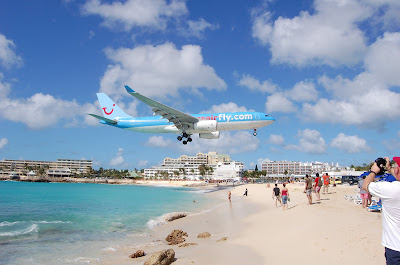 The airport where the runway is by a beach
