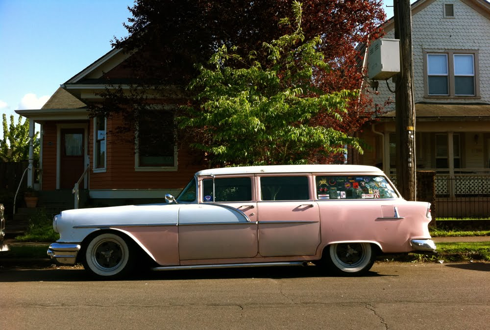 OLD PARKED CARS.: 1956 Pontiac Chieftain Station Wagon.