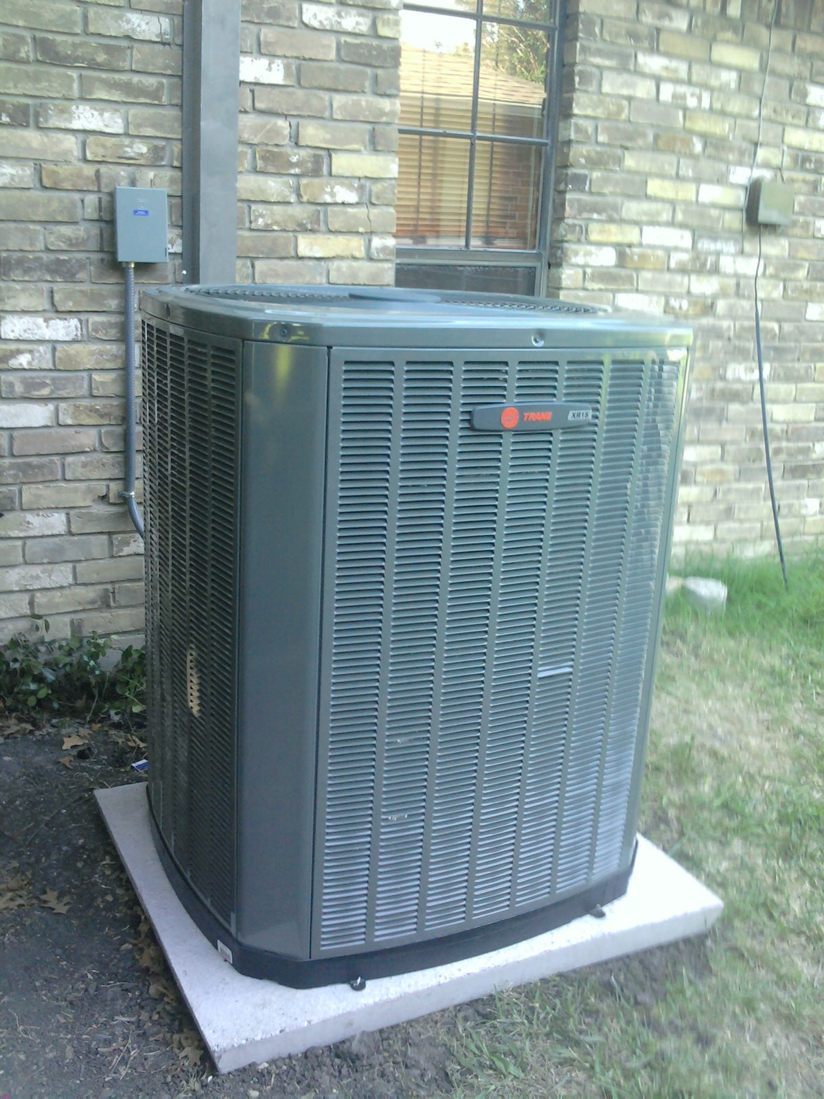 The new outdoor unit is a Trane XR15 heat pump and the new
