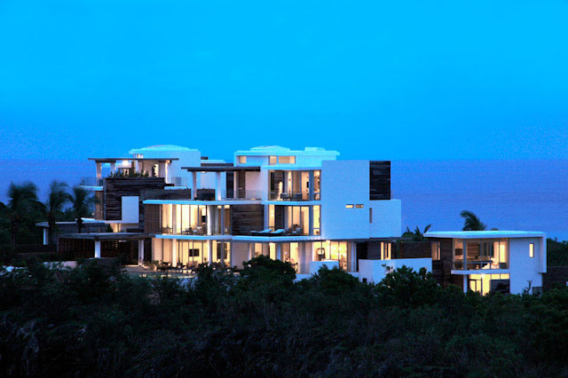 Modern villas with the ocean in the background