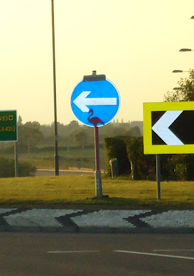 Pink Flamingo on roundabout Sign