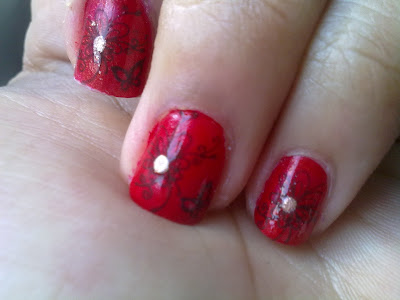 red stamping nail art nails with butterflies and flowers